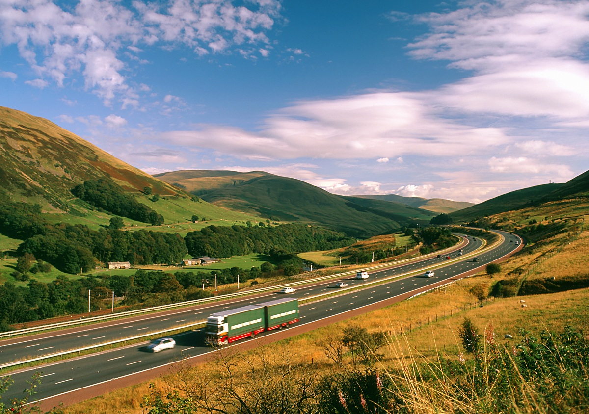 motorway in cumbria lake district countryside green flag