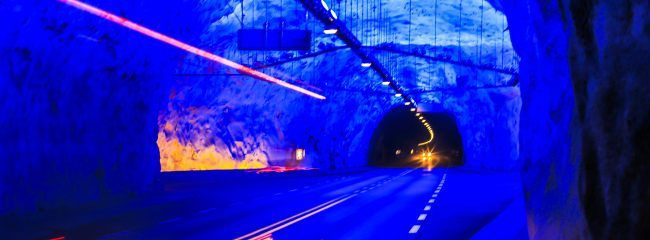 In a tunnel, what do some drivers hold?