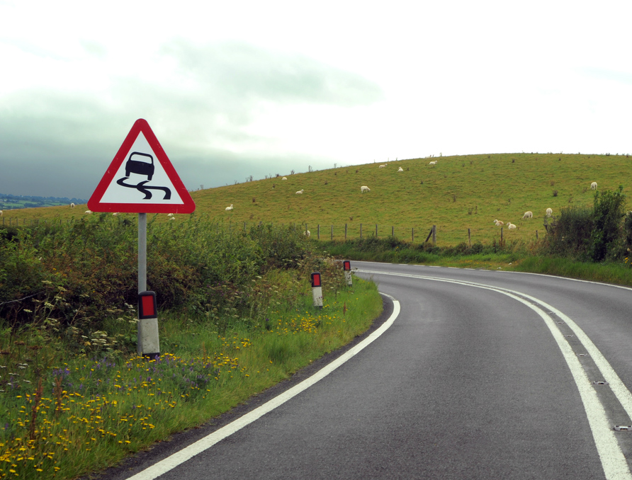 What hazard is shown in this road sign?