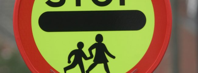 What is the Highway Code advice for a school crossing patrol?