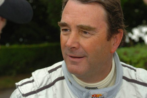 Other than a Formula One World Championship, what has Nigel Mansell earned?