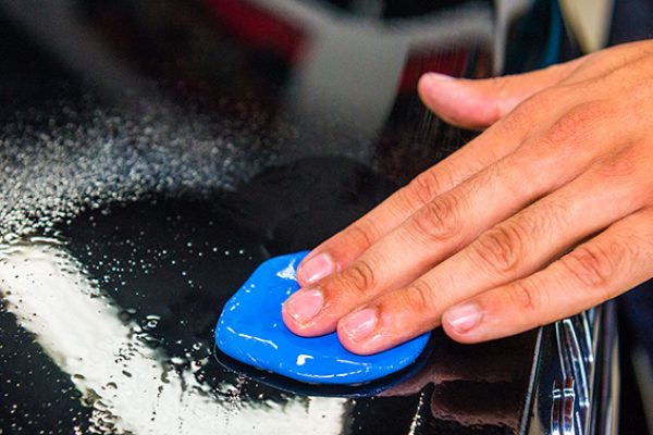 What is a clay bar used for when cleaning a car?
