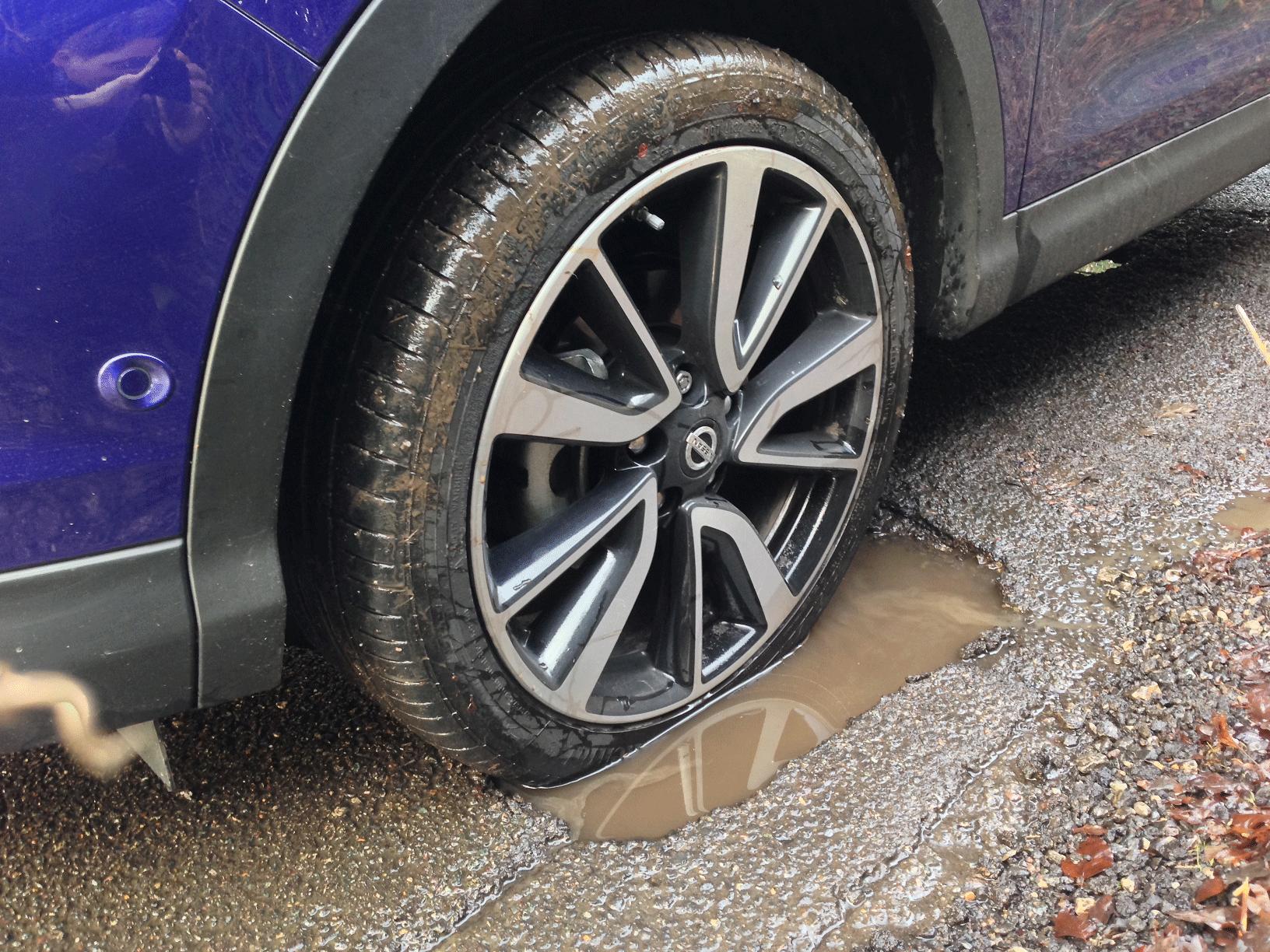 Nissan wheel in pothole