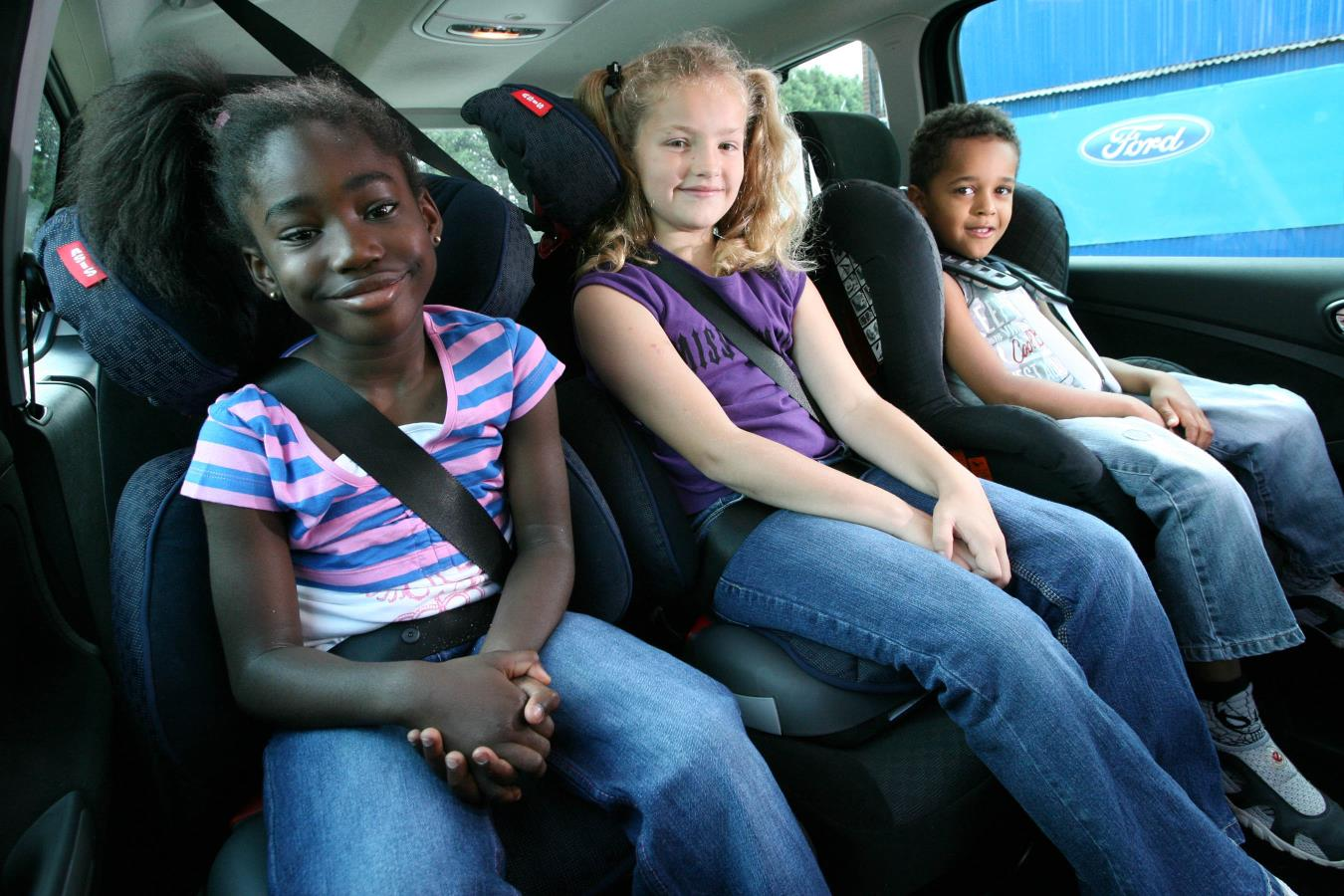 For children of three years and over, what are the seating regulations in a car?