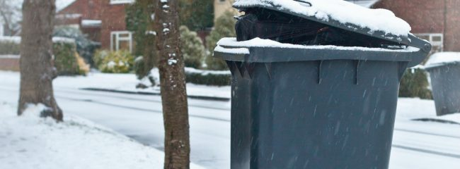 When bins are next to the road what should drivers be wary of
