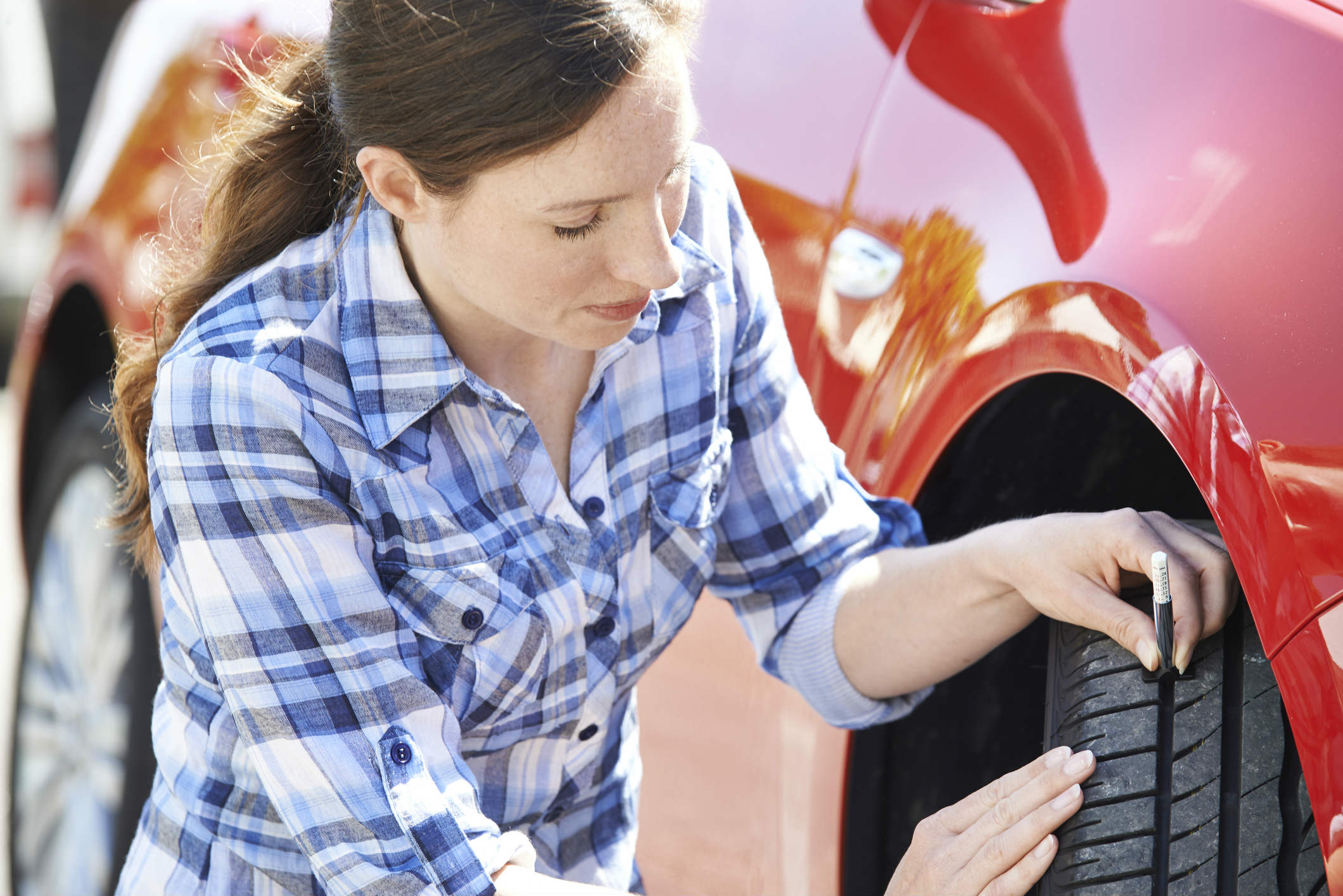 When checking tyres in the summer, what is the legal minimum tread depth?